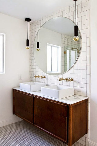 Your industrial bathroom may be under-dressed, use  a large steel mirror—an industrial design basic