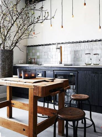 a favourite industrial design surface is wood. Teamed up with bhanging pendant lights in kitchen