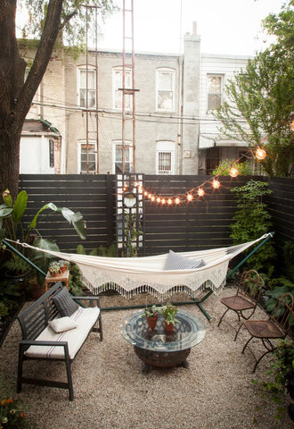 a visually charming, laidback escape with a Bohemian flair. Loving the use of festoon string lights too
