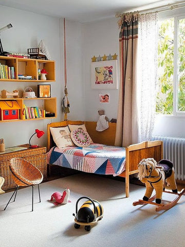 an eclectic room filled with all sorts of toys and books is enough to tickle your child's intellect. Bright pops of colour make it more interesting;