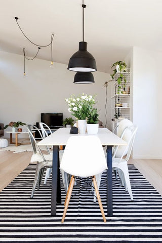 black and white dining room is a classic and will never go out of style