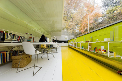 company offers a delightful view of the outdoors, with its unique office perched inside a woodland just 15 minutes away from the city of Madrid.