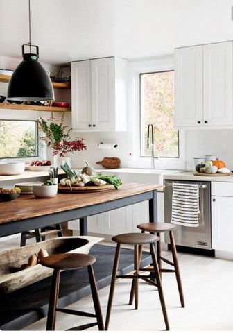 country chic kitchen with black enamel pendant lights