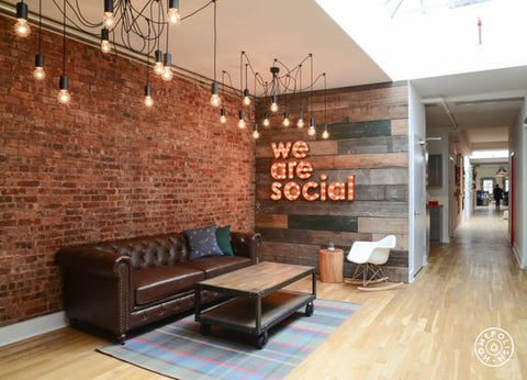 a funky, inspiring workplace using lots of bare bulbs, edison filament bulbs