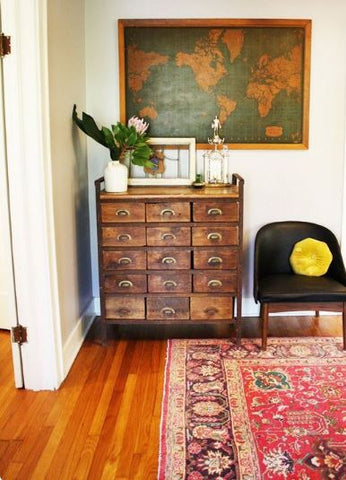 home entrance with a great rug and vintage storage