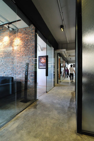 10 industrial chic office interiors fat shack vintage for Office hallway design