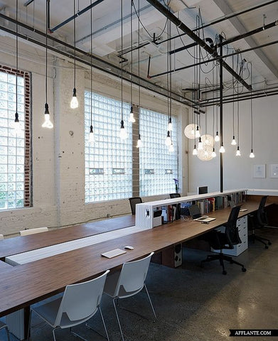 minimalist workplace is made perfect by using Plumen light bulbs