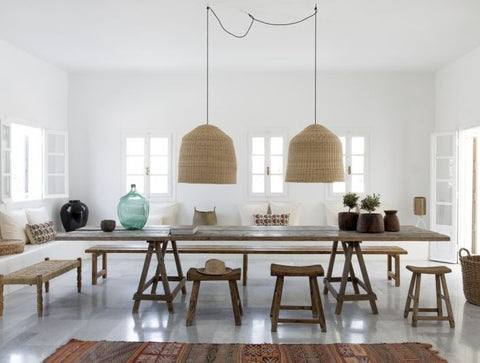 wicker pendant light above dining table image via remodalista