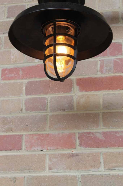 A classic flush mount light option with commercial uses including outdoor taverns seaside restaurants rustic bars and beer gardens.