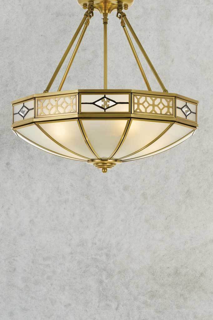 Antique brass metalware art deco ceiling light with bold geometric details