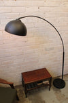 Arc floor lamp styled after achille castiglioni