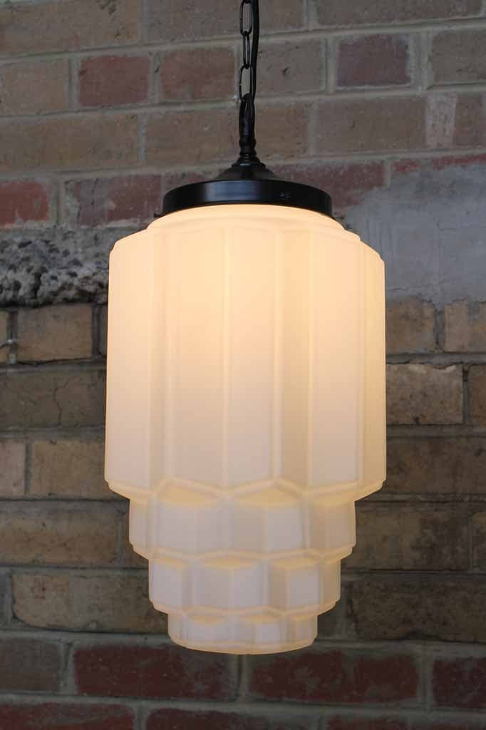 Astor pendant light with art deco influence in the opal glass shade and held with chain suspension cord
