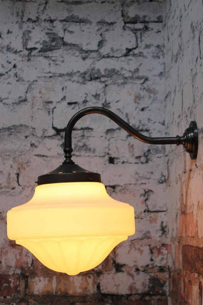 Auberge gooseneck wall light is a opal shade wall light with goosneck quality brass sconce