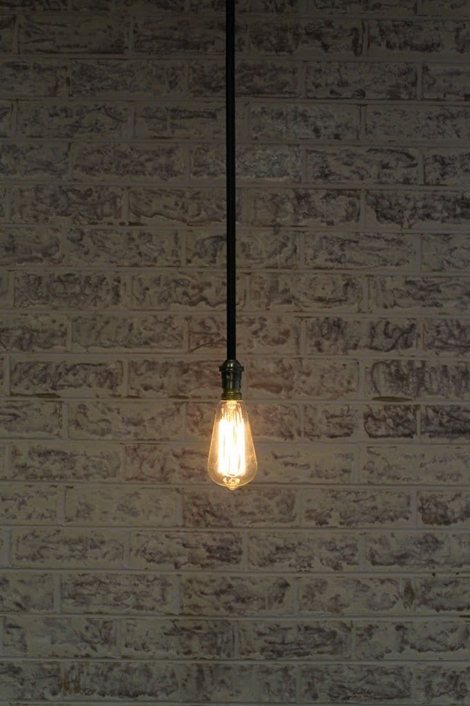 Bare pole pendant with bare bulb and one pole