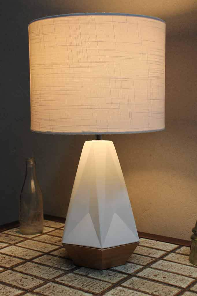 Beachy inspied table lamp. white concrete base. wooden features