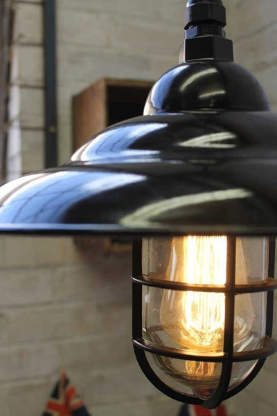 Black enamel shade on industrial bunker pendant light