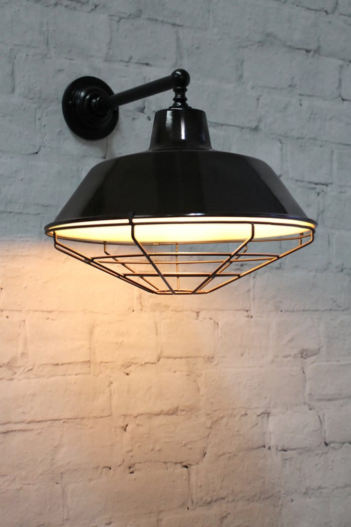 Classic black wall light with brass arm