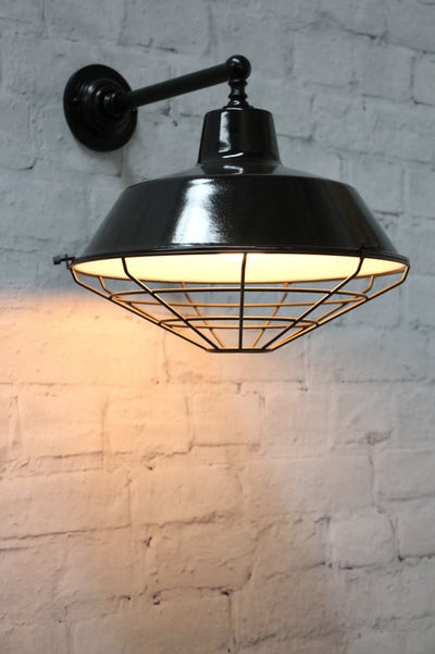Black wall light with metal shade cage cover