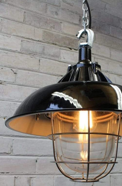 black pendant light with stainless steel cage guard