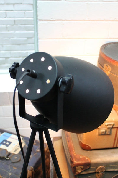 Black metal tripod floor lamp with bell shape adjustable lamp head