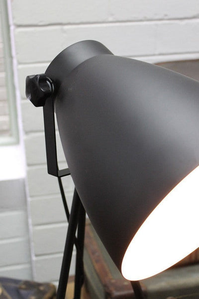 Black metal tripod floor lamp with bell shape lamp head