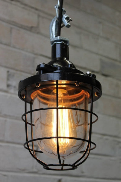 Black cage light industrial pendant with cage guard