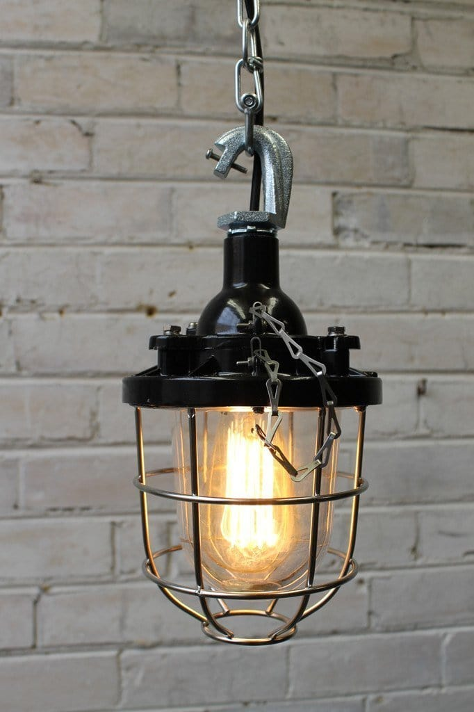 Black cage light industrial pendant with silver cage guard