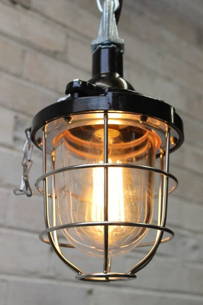 Black cage light industrial pendant with stainless cage guard