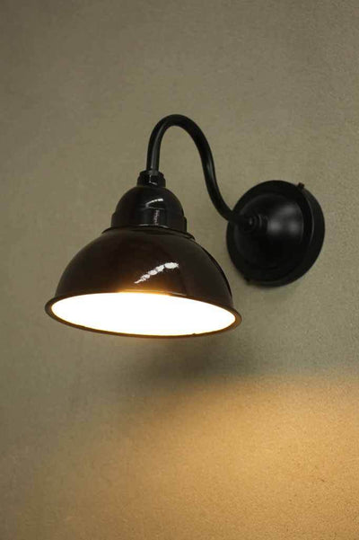 Black outdoor wall light. use in beachfront restaurant seaside cafe countryside eatery or winery.