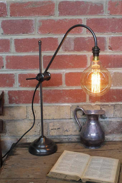 Brass table lamp adjustable curved arm with large filament edison bulb