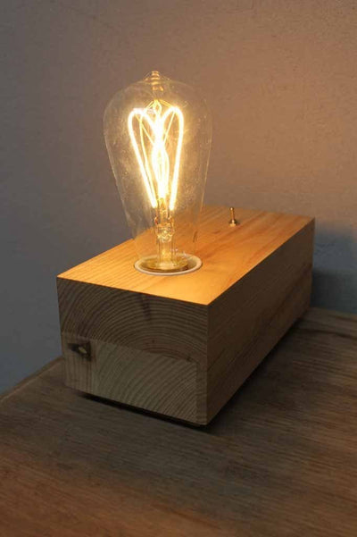 Brick timber table lamp. the natural timber base has a raw finish and create a beautiful soft aesthetic when teamed up with a edison filament bulb