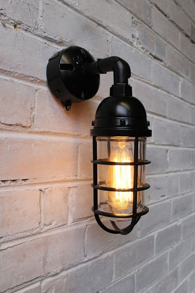 Bunker cage wall light has edison bulb