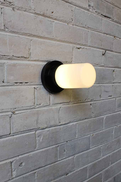 Bunker tube wall light with led teardrop light bulb