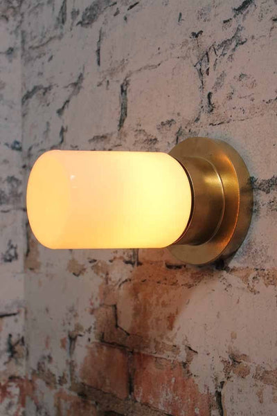 Bunker tube light modern luxe or hollywood regency charm made of metal and finished in a gold paint finish