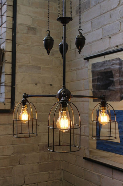 Cage chandelier pulley light has industiral appeal for home cafe or restaurant lighting