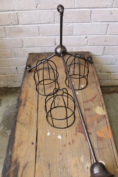 Cage industrial chandelier with black round shades