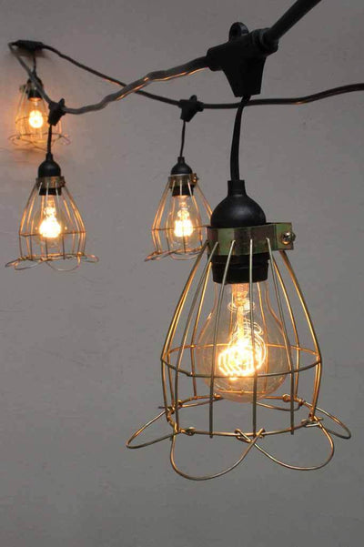 Cage outdoor lights. yellow nickel cage decor. black string lights.