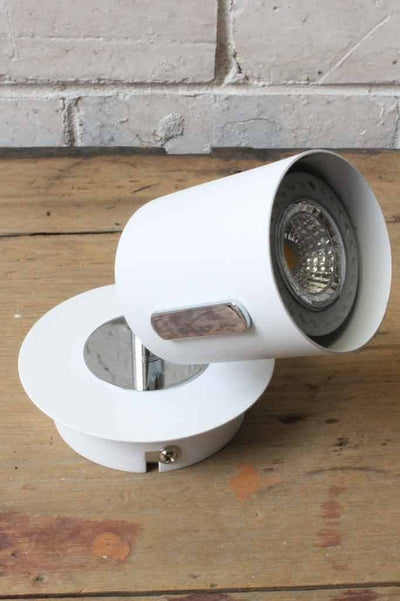 Can led spotlight has a textured white finish with chrome accents