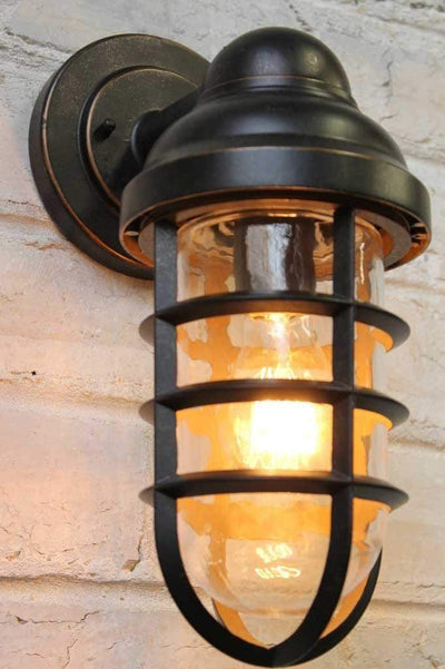 Canal outdoor wall light with a cage shade