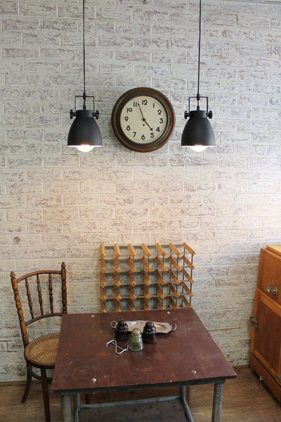 Cellar pendant light pole mount in industrial setting