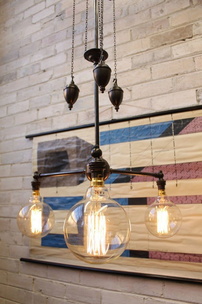 Chandelier pulley light mixes vintage and industrial styles