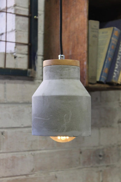Concrete timber pendant with exposed bulb