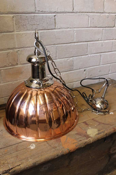 Copper pendant light polished copper and chrome finish. with chain suspension