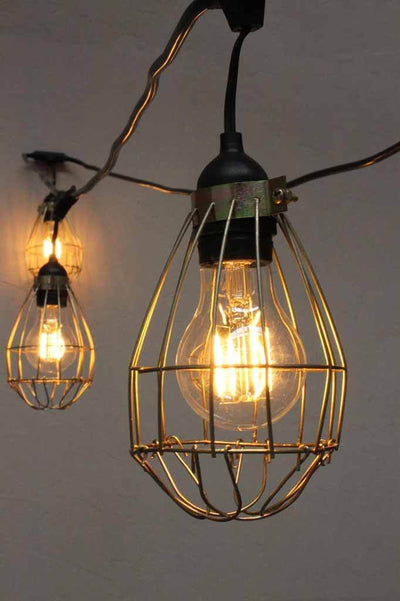 Festoon lighting with hanging lamp holders cages wall plug. outdoor string lights with IP44. festoon lights for exterior or indoor use.