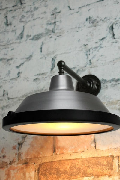 Flat glass cover on vintage steel wall lamp