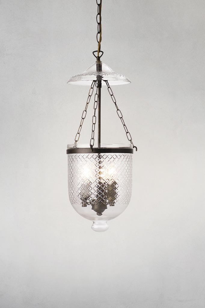 Float glass pendant light with rustic bronze metal ware