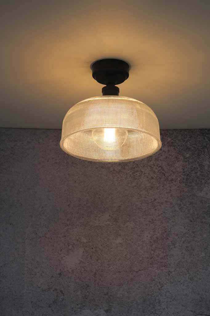 Flush mount ideal for low ceilings. large glass light