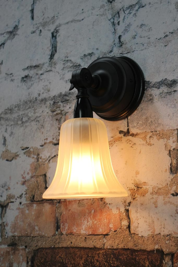 Frosted glass wall light with tulip shade and fluted finish