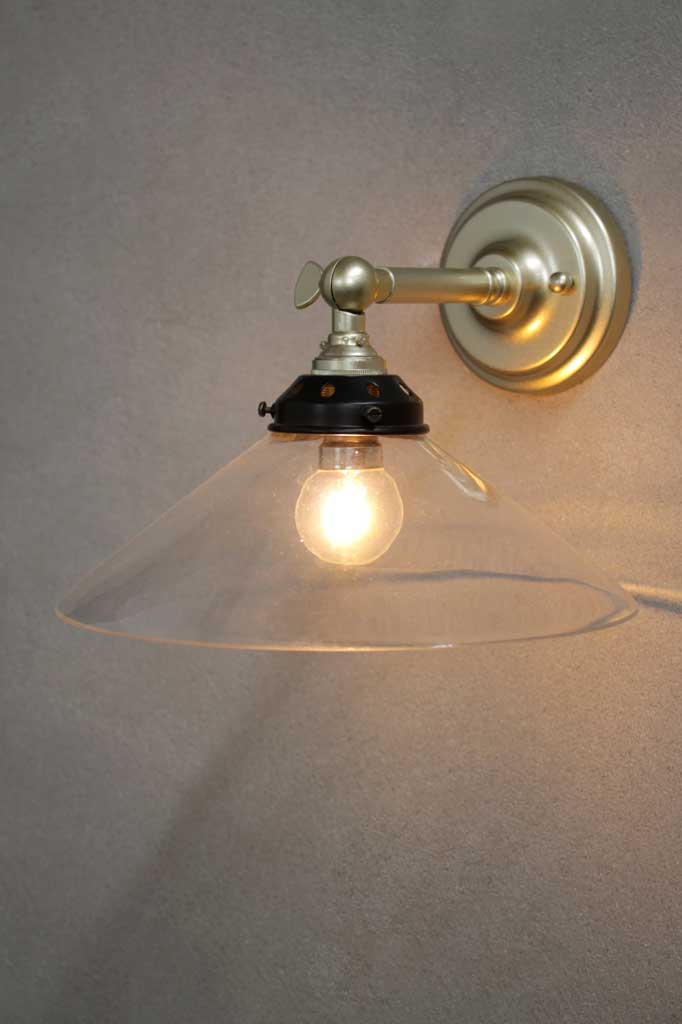Funnel wall light with gold finish