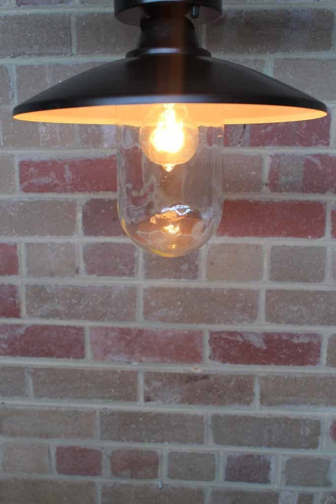 Gasworks under eave light. sleek urban style. outdoor ceiling light with IP44 rating. antique bronze finish